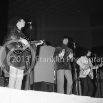 8405 David Crosby, Gene Clark,  Roger  Jim McGuinn of the Byrds performing at the Coliseum in Phoenix Arizona in 1965. Photo by Tom Franklin.