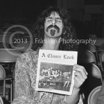 8599 Frank Zappa with a copy of A Closer Look magazine. Photo by John Franklin. Tom's pictures of Frank have been lost. Only this one remains. Hopefully more will be found in the future.