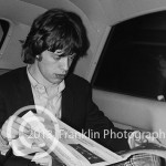 8685 Mick Jagger in the limo on the way to the concert. Photo by Tom Franklin.