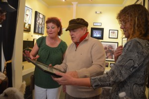 Tina shows local legend Pat McMahon a saved fan club letter from Hub Kapp and the Wheels.